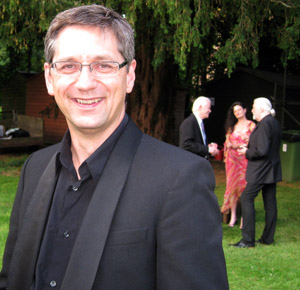Bruce Martin, flute, photographed at Nuthurst in 2011 with Jon in the background