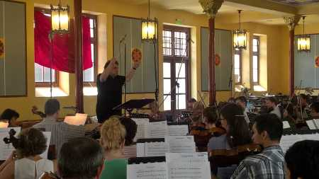 Paul Mann rehearsing the strings of the Kodály Philharmonic Orchestra for the first volume of pieces for Music For My Love.